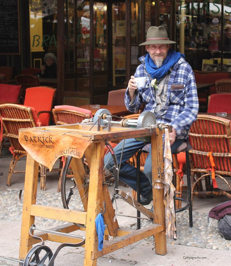 Traditional knife sharpening, market day, Mirepoix, Ariege, south of france