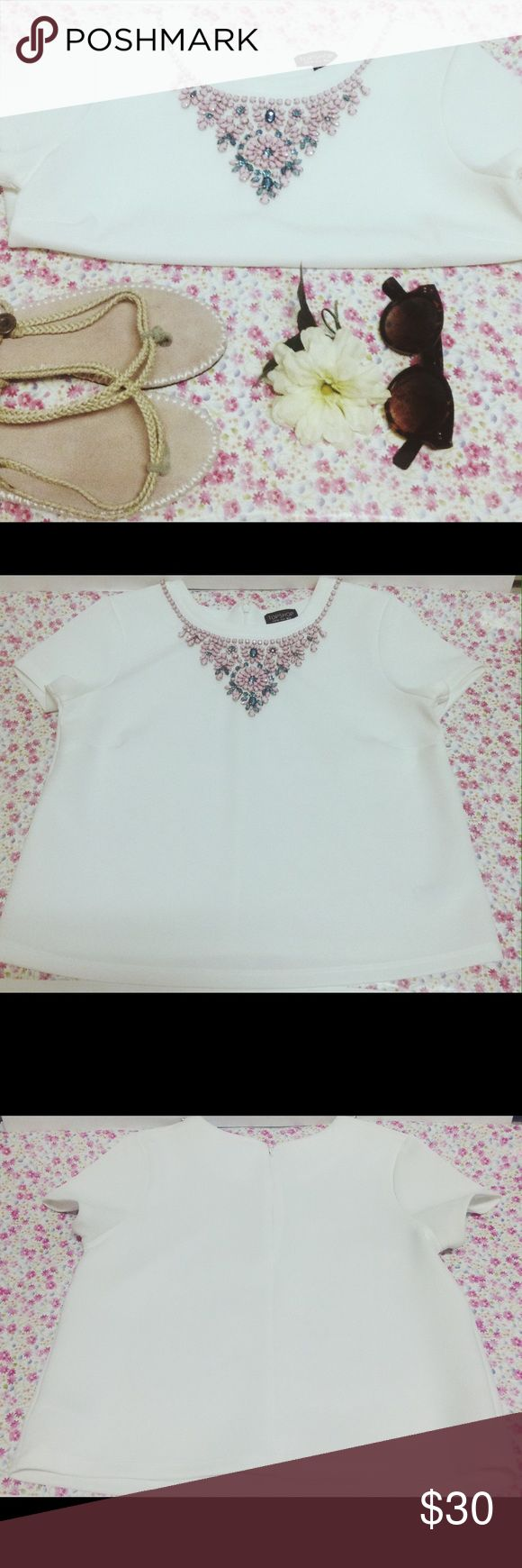 "TopShop White Jewel Embellished Top Bright white TopShop top with beautiful summertime pink and blue colored jewels zipper back. Only flaw is a very small knick on the back as pictured above ( hard to see) size 8. measurements chest 19"" length 20.5"" Topshop Tops Blouses"