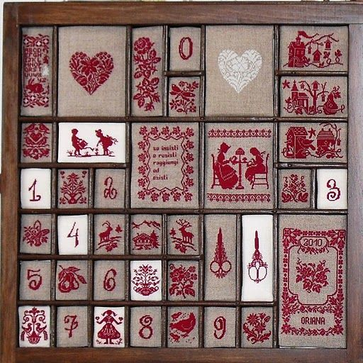 Ok, another sweet idea...An old printers box used to frame small needlework pieces, could be used to frame new work or vintage needlepoint pieces.
