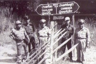 Do you see anything strange in this picture of the Thai - Cambodia Border circa 1950. Is it my eyes or are there twins standing either side of the 'Bamboo Curtain?'
