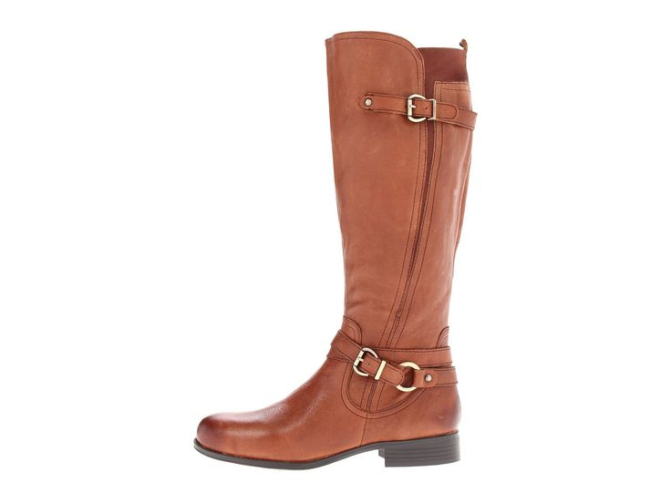 - Look polished in the Juletta boot from Naturalizer®. - Leather upper in knee-high riding boot style with round toe and buckle straps at ankle and shaft. - Elastic gored panel at rear collar for a pe