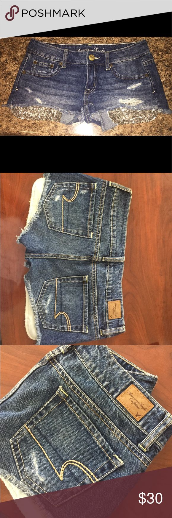 American Eagle ~ Low Rise ~ Denim Sparkle Shorts Super cute Low Rise Denim shorts from American Eagle. Lightly used. In great condition. Pet and Smoke free home. Can mail out today !! Size 0 American Eagle Outfitters Shorts Jean Shorts