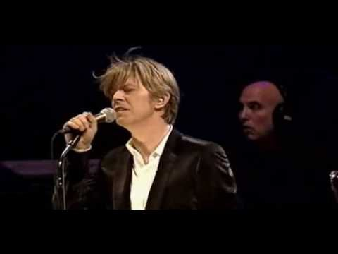 "David Bowie - ""The Alabama Song"" by Bertold Brecht performed live in Berlin 2002. Watch for the part where he sticks out his tongue at Gail Ann Dorsey."