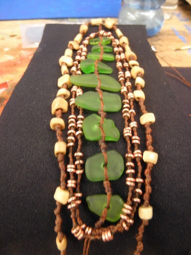 green beach glass bone and copper beads on waxed cotton