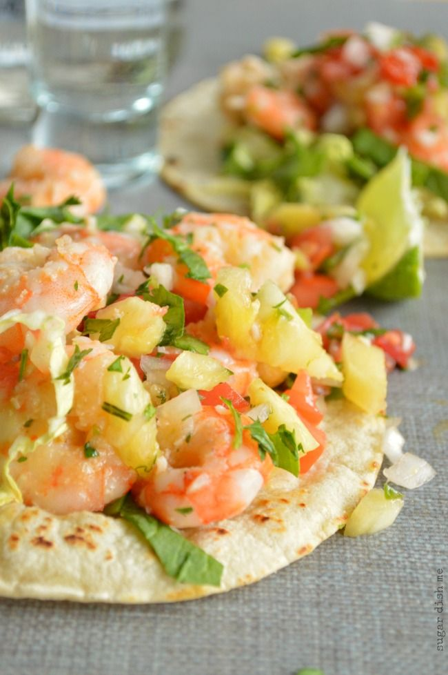 An easy recipe for tequila shrimp piled high with a sweet and spicy pineapple pico de gallo. Tequila Shrimp Tostadas are quick, simple, and so fresh!