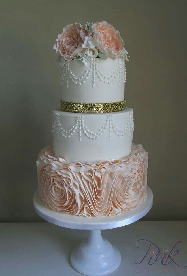 Peach ruffle and pearl wedding cake with david austin sugar roses and sequin band