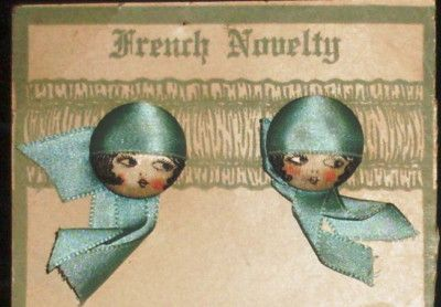 Darling and oh so rare to find, Vintage Flapper girl, garter buttons.