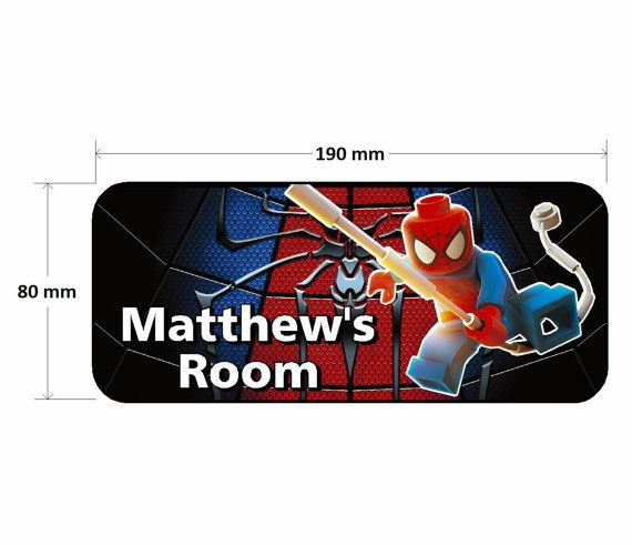 Personalised Lego Spiderman Childrens Bedroom Door Sign  Add any name of your choice to the sign as shown. Please just let us know the name you would like when ordering.  Each of our door signs are made from a high quality 3mm aluminium composite board with printed and gloss laminated vinyl graphics making it fully weatherproof, long lasting and can easily be wiped clean without any removal of the image.  They are supplied complete with double sided tape on the rear for fixing to any flat…