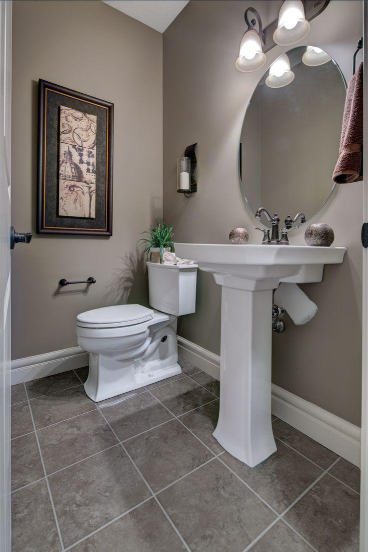 Lovely half bath on the main floor - love the #pedestal sink!