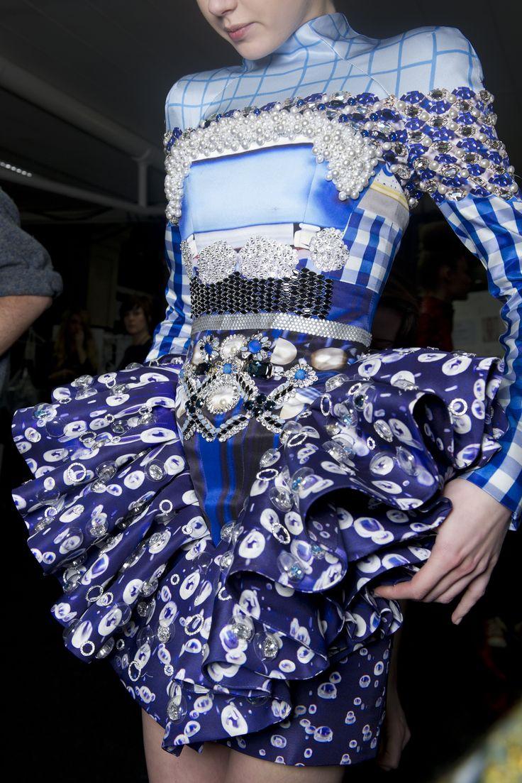 Blue structured dress with ruffles, mixed prints & embellishments; vivid printed fashion // Mary Katrantzou