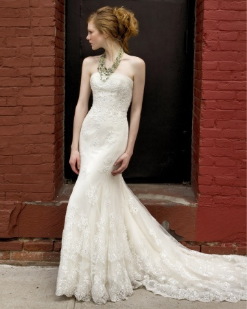 A gorgeous cascading Alencon lace train on Henry Roth's strapless tulle wedding dress