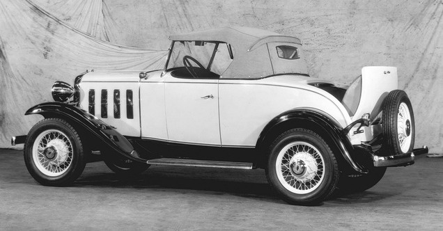 1932 Chevy Sport Roadster. My firsr car was a plain jane 1932 that I bought in the summer of 1953. Ray