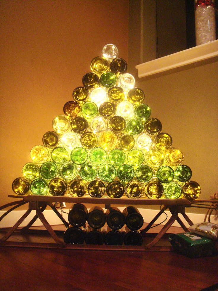 I'm sure you've seen those festive holiday wine bottle trees, most of them are towering. Give this one a try, not as much pressure as the large tree. What do you do with all those wine bottles? Anyone else repurpose them?