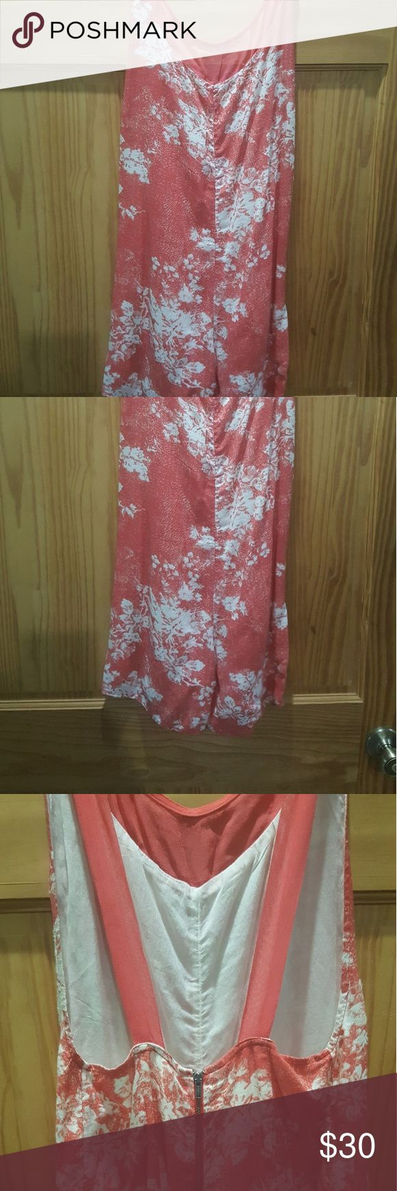 Free people corral and ivory floral print romper Free people corral and ivory floral romper sz xsmall, very cute! Small pin hole in the fabric just before the strap. Please second to last see pic. free people Other