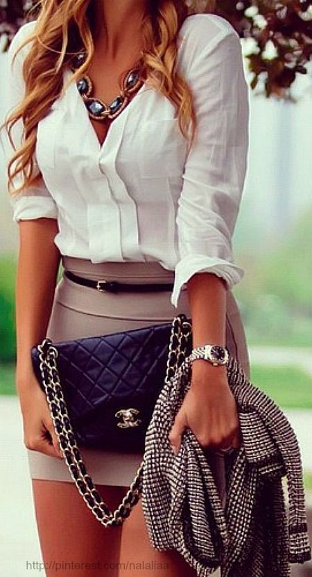 Shop this look on Lookastic: http://lookastic.com/women/looks/necklace-dress-shirt-belt-mini-skirt-watch-crossbody-bag-jacket/7707 — Black Necklace — White Dress Shirt — Black Leather Belt — Tan Mini Skirt — Silver Watch — Black Quilted Leather Crossbody Bag — Black and White Tweed Jacket