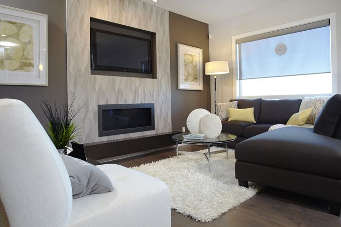 Living room in the Tofino II showhome in Hillcrest in Airdrie by Shane Homes.