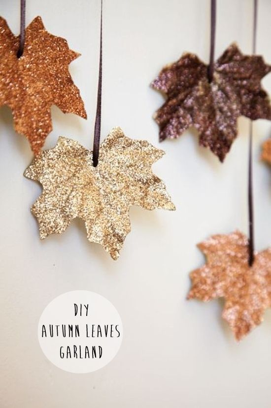 This autumnal craft idea from 6th Street Design School is simple, cheap and looks GREAT! The leaves are so pretty and shimmery, without feeling too 'homemade'. You could hang yours across a fireplace, or maybe along the wall by some stairs. Once you've assembled all the supplies it should only take about ten minutes to put together. Shopping list: – Artificial leaves, available via Amazon (or the Dollar Store if you're in the US) – PVA glue – Glitter in autumnal colours, these ones from Etsy…