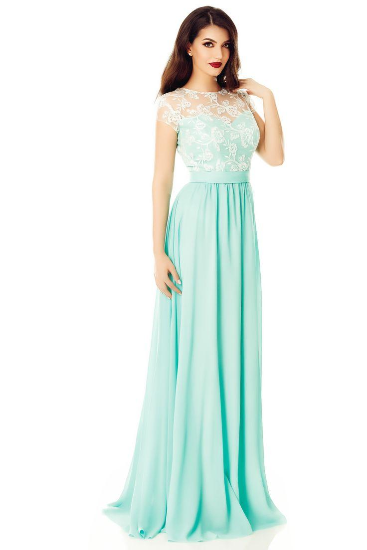 Rochie Cassia Verde Mentă - Delicatețea unei rochii de seară lungi în nuanțe proaspete de verde mentă are un efect deosebit atât asupra imaginii, cât și asupra stării tale de spirit, îmbiind la calm și relaxare. Cu bustul confecționat din dantelă albă brodată cu paiete și cu fusta din voal fin, rochia lungă Cassia este ideală pentru petrecerile verii, impresionând prin aerul vaporos și linia fluidă, avantajoasă pentru orice siluetă. Modelul floral deosebit al dantelei și cordonul din talie…