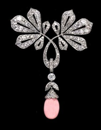 Art Nouveau diamond-set brooch with a conch pearl drop.