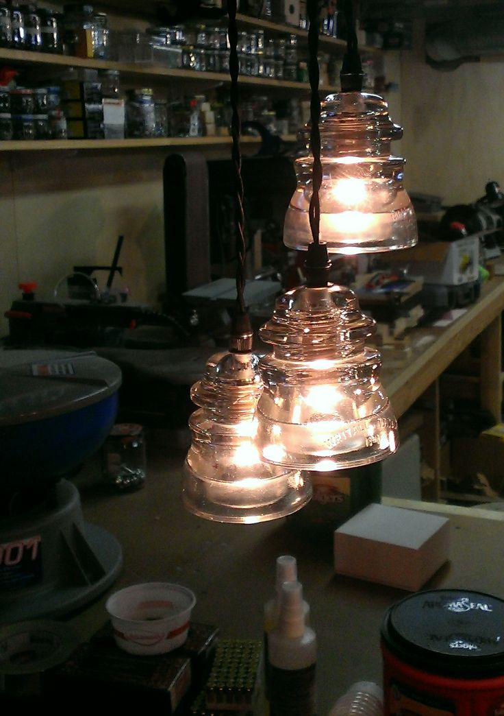 Antique Insulators repurposed into lighting, authentic vintage glass paired with modern wiring for a remarkable home accent lighting piece.    3 Insulator Pendant fixture, here with CLEAR insulators, with standard black canopy (mounting kit w/ strain reliefs provided).  Wiring is knotted and has extra length for installation and adjustment by electrician. Jack Riley Lighting and Metalworks – TAGS: WWW.JACKRILEYLIGHTING.COM.... LIGHTED glass doorknobs, antique crystal, vintage architectural…