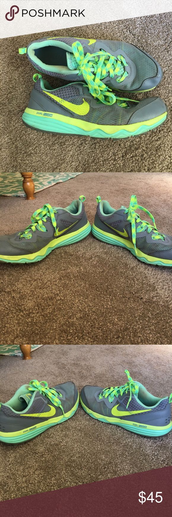 Nike Dual Fusion Trail Tennis Shoes Vibrantly colored tennis shoes. Great for outdoor running! Normal wear and tear and some staining. Nike Shoes Sneakers