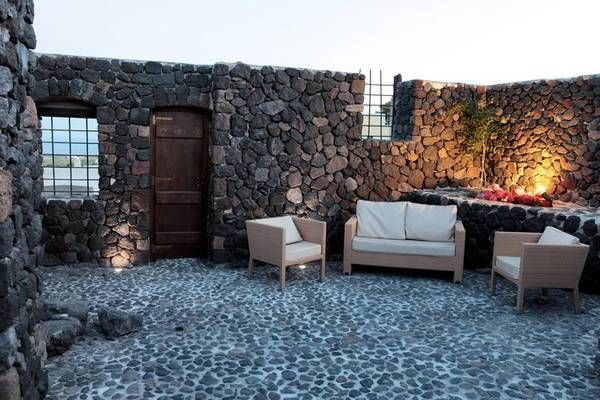 Beautiful villa located in Santorini, Greece. Peacefully situated on top of a hill with views of stunning vineyards.