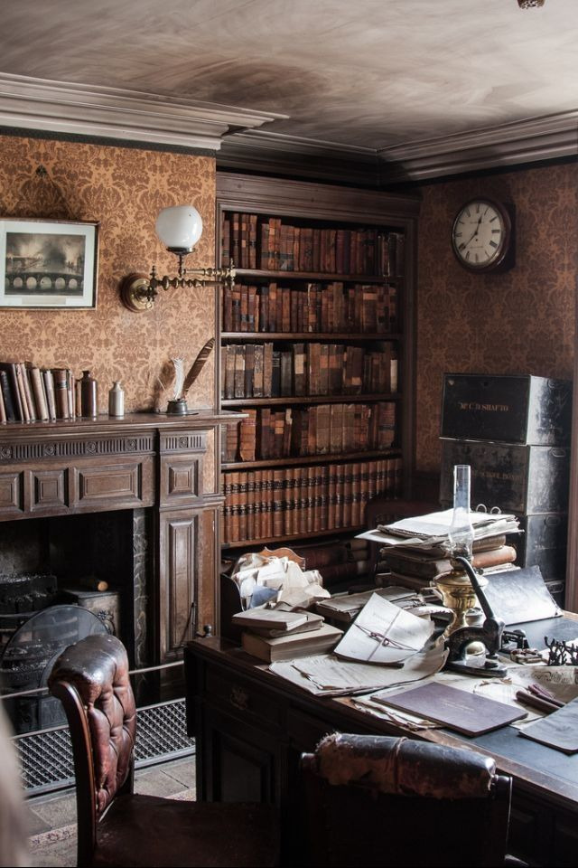 Lots of wood and leather, a working fireplace, and books lining every wall
