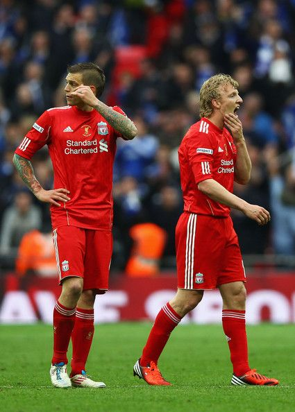 Daniel Agger of Liverpool and Dirk Kuyt of Liverpool look on at the final whistle during the FA Cup with Budweiser Final match between Liverpool and Chelsea at Wembley Stadium on May 5, 2012 in London, England.