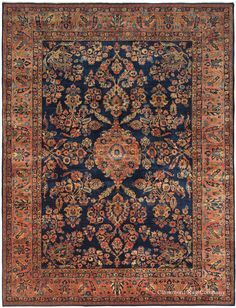 Mahajiran Sarouk vintage Persian carpet is a showcase of inspired early 20th century Oriental rug weaving.