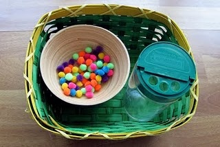 Fine Motor. TIny pompoms to shove in a parmesean container.
