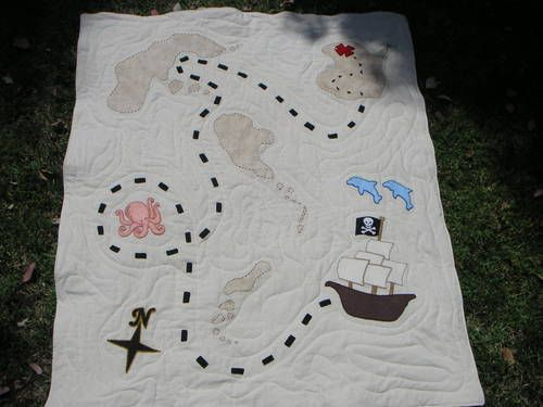 "treasure map quilt. this would be an AWESOME idea for a ""couple's"" life story from the time they met til they got married... stitching different words small pics etc. (the easiest stuff to stitch at least)."