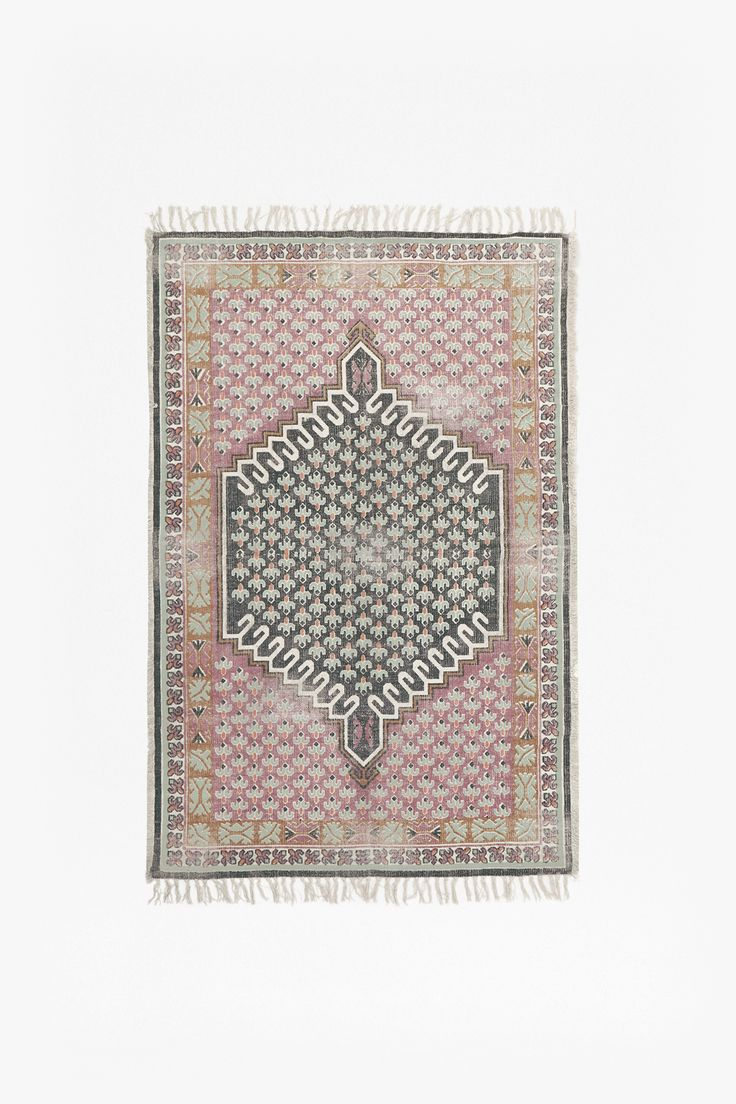 Muted pink and grey rug