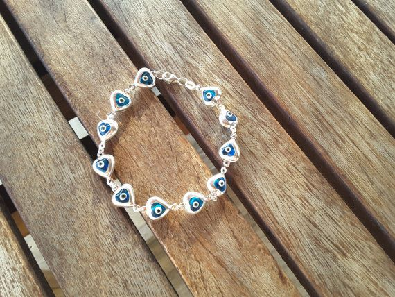 Check out this item in my Etsy shop https://www.etsy.com/listing/116753652/heart-shaped-glass-evil-eye-silver