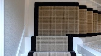 Brintons plaid carpet trimmed in black velvet. Perfect for our house with my husband's plaid obsession.
