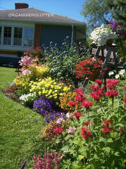 Organized Clutter: My Proudest DIY Moment: 20 years in the making   (a beautiful flower bed with descriptions)