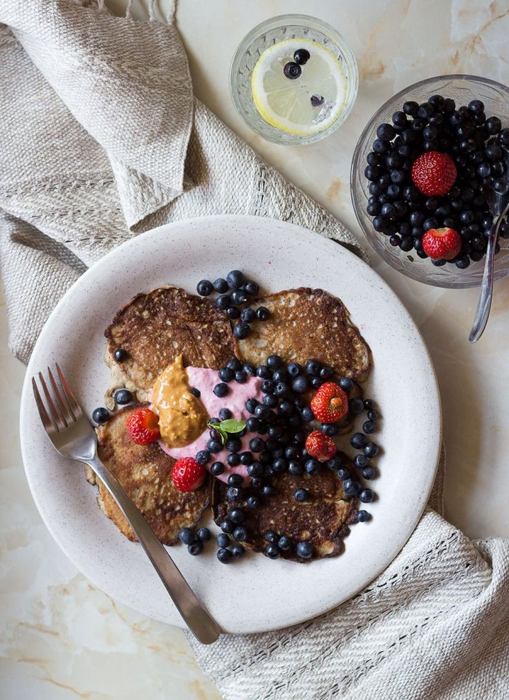 Banana Pancakes with Raspberry- Coconut wiped Cream and lots of fresh berries <3