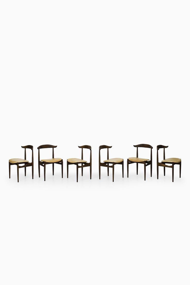 Knud Færch dining chairs model 215 at Studio Schalling