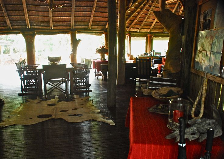 Relax in the lounge / dining area at Sibuya Game Reserve Forest Camp reached via boat along the Kariega River from Kenton on Sea, Eastern Cape, South Africa www.sibuya.co.za