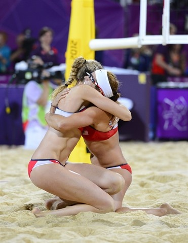 Misty May-Treanor (right) and Kerri Walsh (left) celebrate winning the gold medal after defeating April Ross and Jennifer Kessy (USA) in the women's beach volleyball gold medal match at the 2012 London Olympics - #olympics