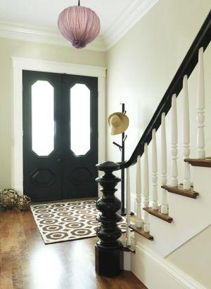 Black door, black banister; LOVE those front doors and black banister.