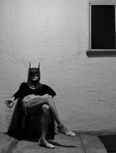 Batman/girl drinking wine.