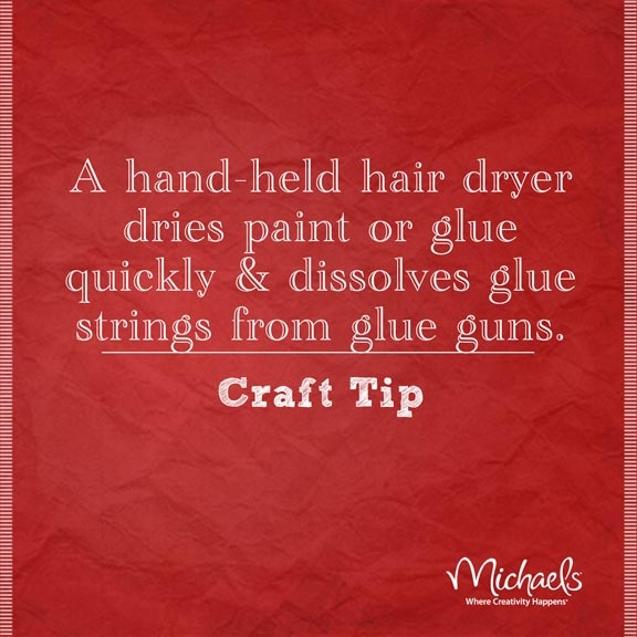 A hand held hair dryer dries paint or glue quickly & dissolves