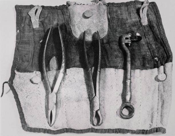 Barber surgeon set containing a dental key and two forceps in a cloth case. These dental instruments were part of an early 19th century barber surgeons kit. From Smithsonian Institution, Neg. No. 43-4221.