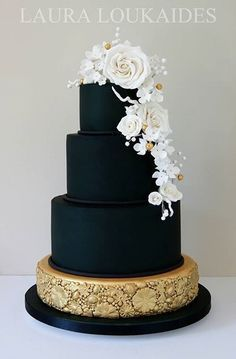 Cake by Laura Loukaides. Black and Gold Tiered Cake