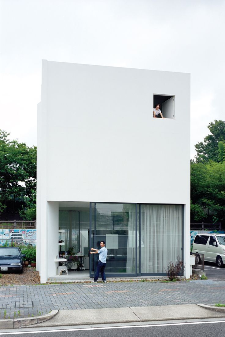 An unassuming white cube in Nagoya, Japan, is more than it appears at first glance, with a flower shop on the ground level and an apartment above. Photo by Takashi Homma.