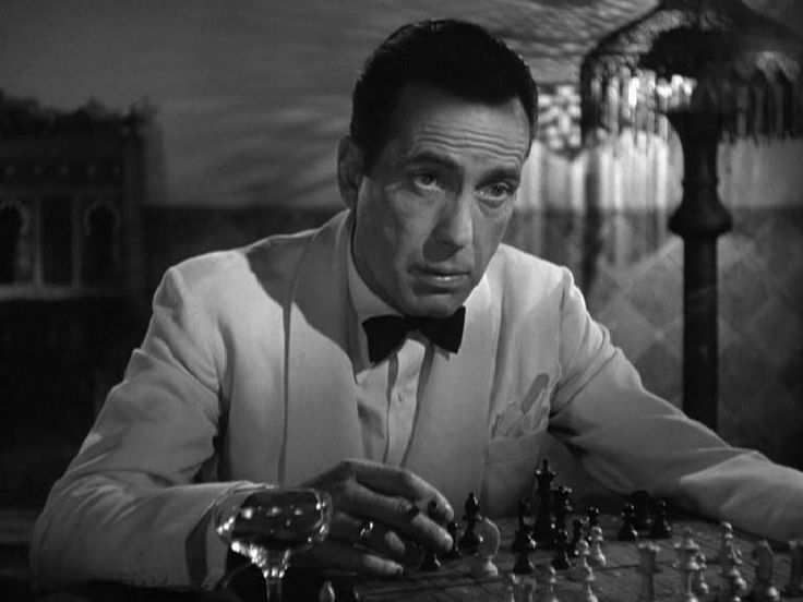 """In Casablanca, Rick Blaine was a chess player. In real life, Humphrey Bogart loved the game of chess, and he was an excellent player. In fact, he once played seven-time U.S. chess champion Samuel Reshevsky to a draw. At the onset of the Great Depression, Bogie made food money by playing any challenger for 50 cents. To support the troops during World War II, Bogart played chess games via mail, until the FBI, concerned that the chess moves were secret codes, forced him to stop."""