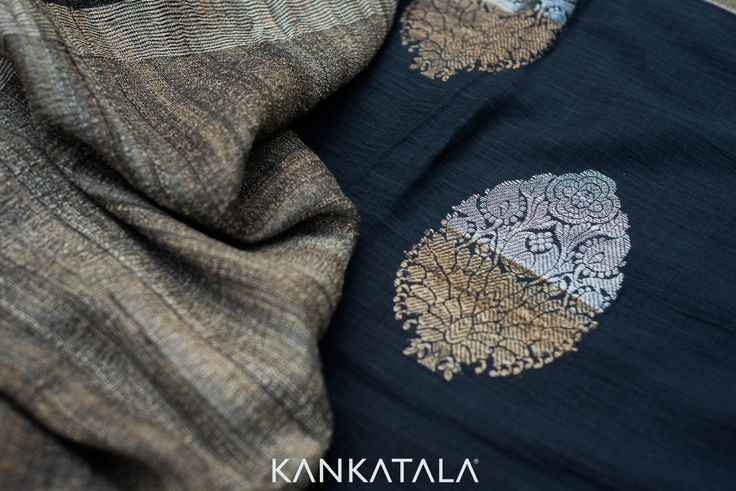 Bold and black is always brilliant and beautiful! Handspun Chanderi saree in solid black with a jute border, the ethnic gold and silver motifs make this saree a classy choice for party wear. #ChanderiSilk #Saree #JuteSaree #Kankatala