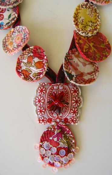 Kaori necklace by blue-field, via Flickr.  I love this cool fabric necklace.