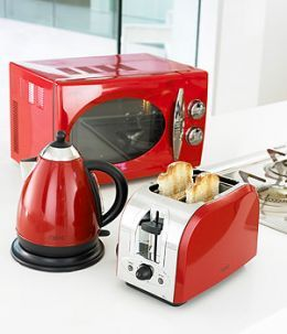 i like the idea of red kitchen appliances or even silver!!
