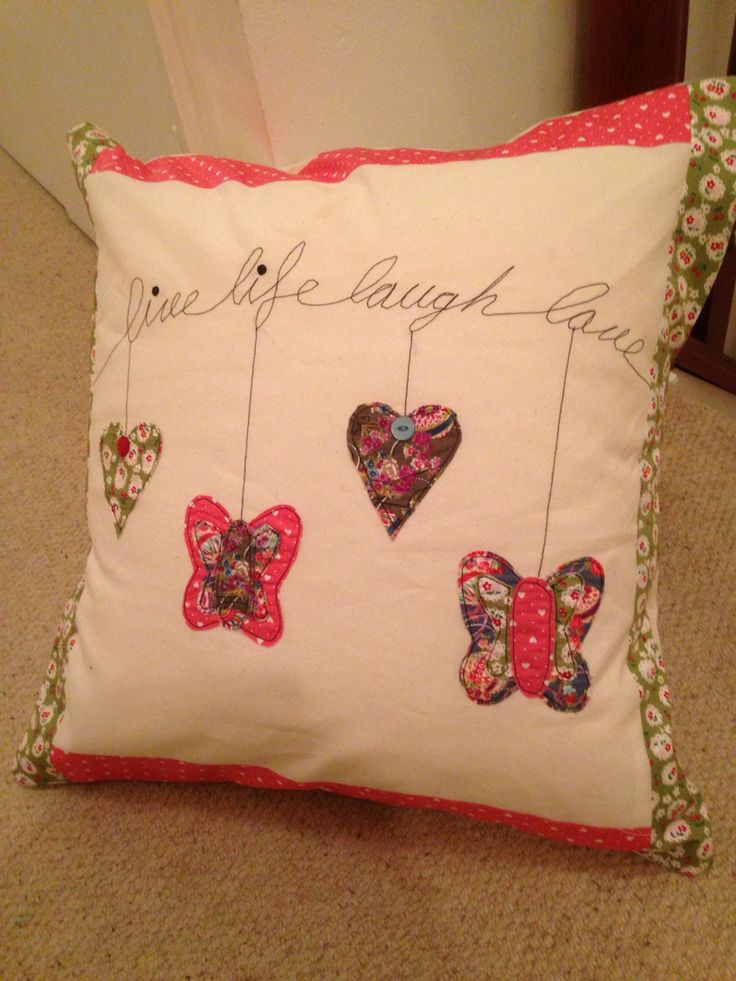 Appliqué heart and butterfly cushion